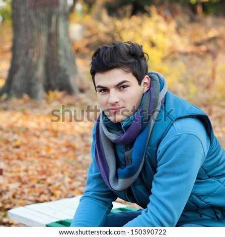 Young stylish man portrait, autumn outdoor. - stock photo