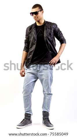 Young stylish mulatto in a leather jacket. - stock photo