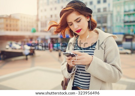 young stylish pretty woman with hat posing in the city streets. vacation europe - stock photo