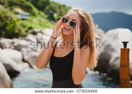 young stylish sexy hipster woman on vacation, aviator sunglasses, happy, smiling, enjoying sun, tropical island blue lagoon landscape - stock photo