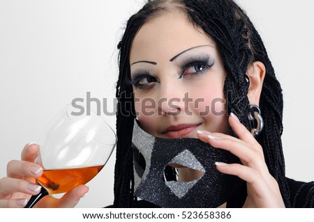 young stylish woman with dreadlocks drinks wine on white background
