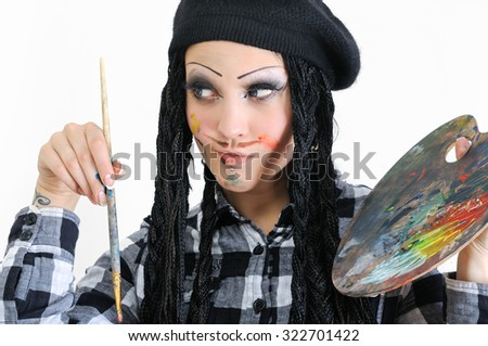 young stylish woman with dreads in painter style holding brush and palette - stock photo