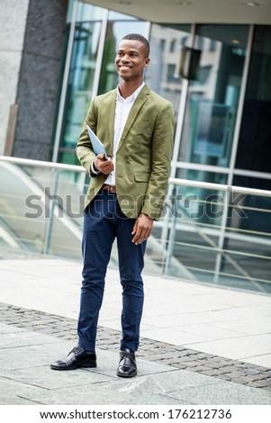 young successful african business man outdoor in summer self confident - stock photo