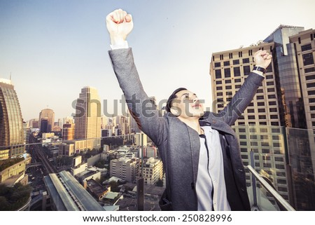 young successful asian businessman with urban background,vintage effect - stock photo