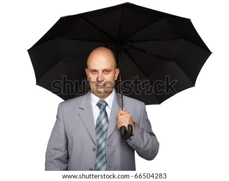 Young successful business man with a black umbrella on a white background