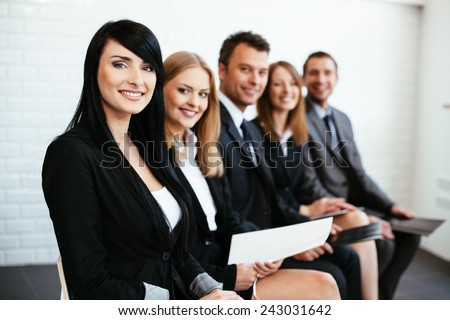 Young successful business woman waiting for job interview - stock photo