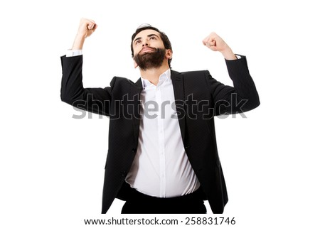 Young successful businessman making fists. - stock photo