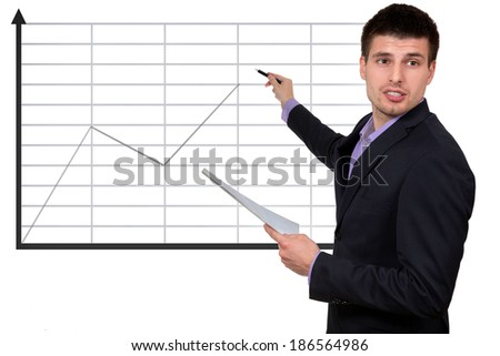 Young successful businessman,presenting company`s success, isolated on white background.