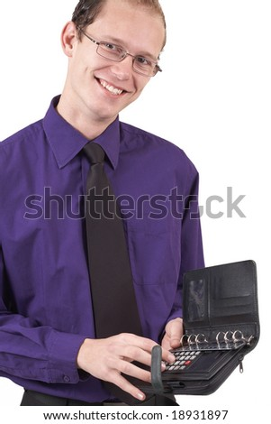 Young successful businessman wearing an office clothes working on a calculator. Isolated on white background
