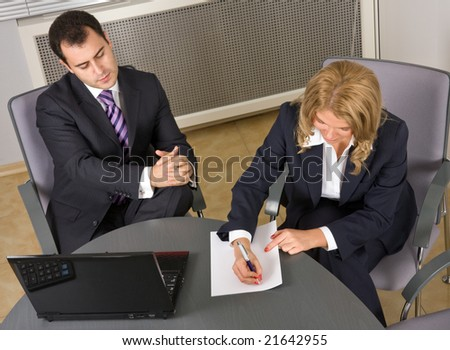 Young Successful businessteam at a meeting in the office - stock photo