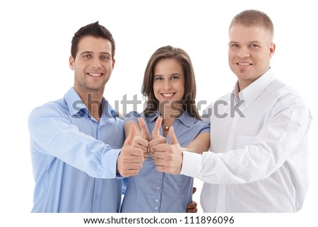 Young successful businessteam giving thumb up, smiling, team spirit, isolated on white. - stock photo