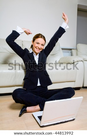 Young successful businesswoman with  laptop