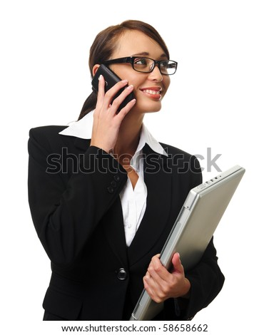 Young successful career woman holds her laptop and talks on her mobile phone
