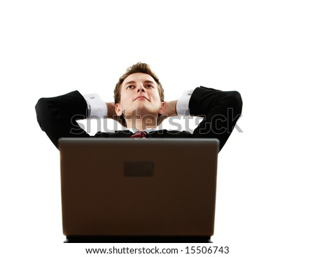 young successful confident man with laptop dreaming - stock photo