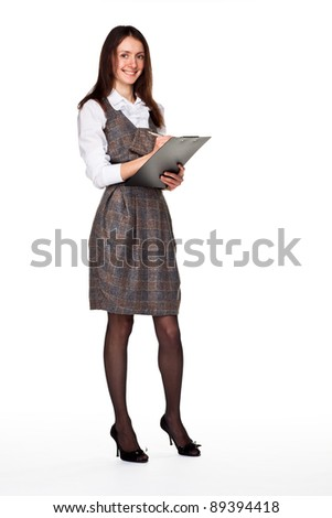 Young successful smiling businesswoman with clipboard; full length portrait isolated on white