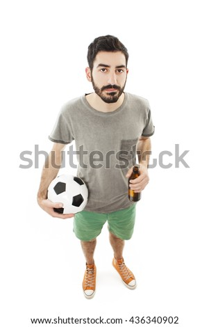 Young supporter man with ball and beer bottle, look disappointed. Isolated on white background