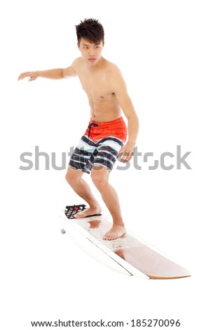 young  surfer simulate surfing pose - stock photo