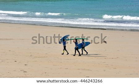 Young surfers on the Trestraou beach of Perros-Guirec in Brittany, France