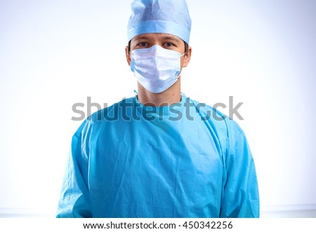young surgeon standing with his arms crossed