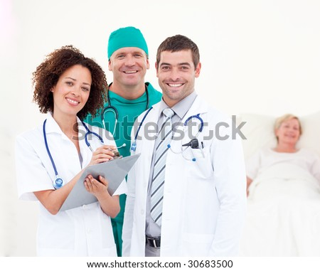 Young Surgeon with Doctors Looking after a senior Patient - stock photo