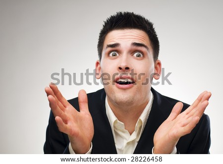 young surprised business men close up shoot - stock photo