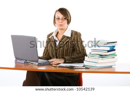 young surprised businesswoman typing on laptop