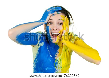 young surprised  woman covered with paint looking at camera - stock photo
