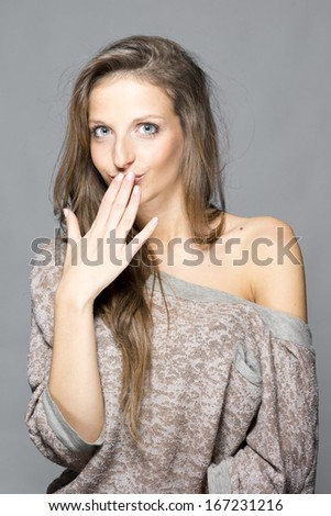 "Young surprised woman ""oops"" - stock photo"