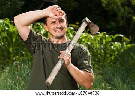 Young sweating farmer after a day of work - stock photo