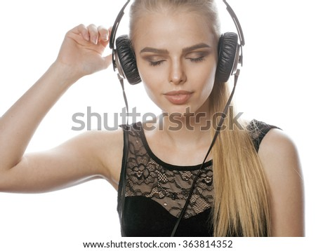 young sweet talented teenage girl in headphones singing isolated on white - stock photo