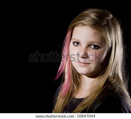 Young, sweet  teenage girl posing on black background - stock photo