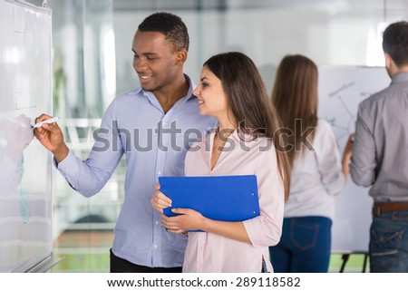 Young talented business team creating business strategy at office. - stock photo