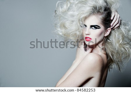 Young tall attractive woman with long curly hair. - stock photo