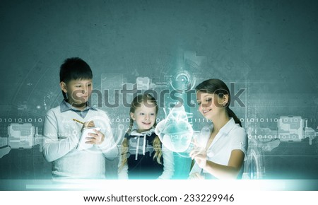 Young teacher and kids of school age at anatomy lesson - stock photo