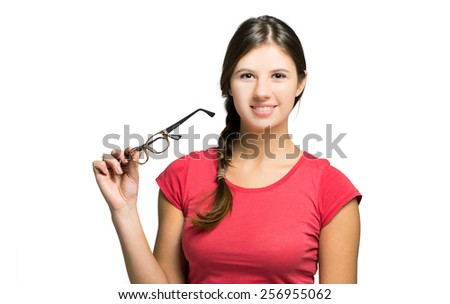 Young teacher holding her glasses - stock photo