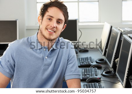Young teacher in empty classroom - stock photo