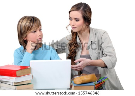 Young teacher with boy - stock photo