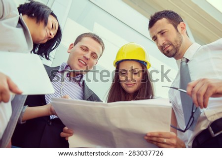 Young team of engineers working together - stock photo