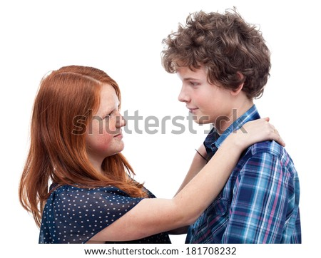 Young teen couple huging while the are looking in each other's eyes.They are in love . - stock photo