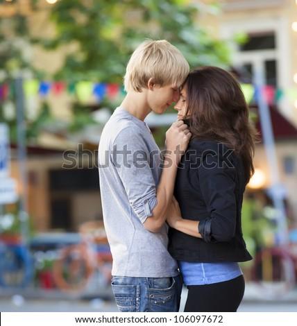Young teen couple on the street - stock photo