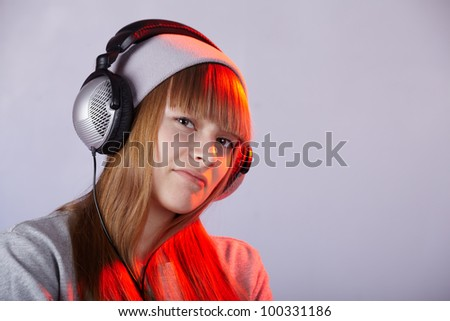 Young teen girl with headphone in studio - stock photo