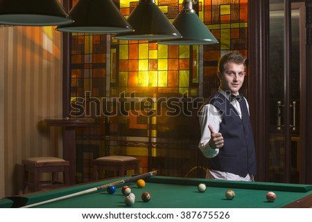 Young teen playing pool - stock photo