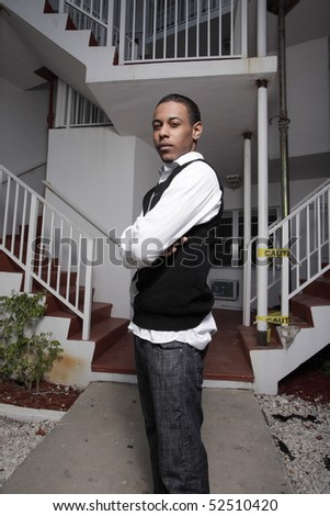 Young teen with arms crossed - stock photo