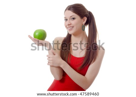 young teen woman pigtails green apple smile isolated - stock photo