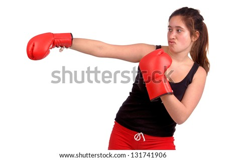 young teenage girl boxing isolated in white