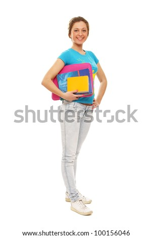 Young teenage girl holding books. Isolated on a white background.
