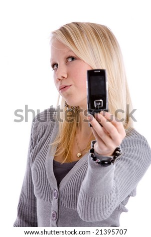 Young teenage girl posing for her own cameraphone