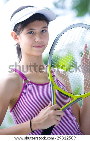 Young teenage girl ready for game of tennis - stock photo