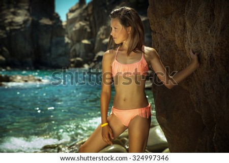 Young teenage girl relaxing on sunny vacation day. Spain. Summer photo. - stock photo