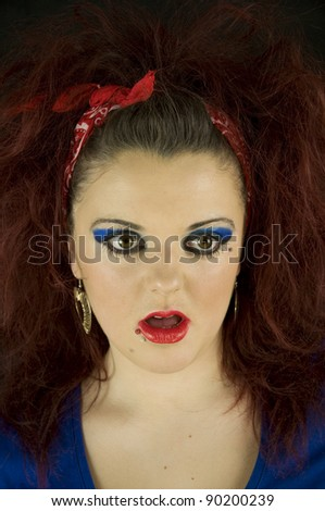 young teenage girl shocked in bright makeup - stock photo